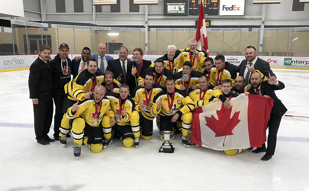A group of men posing for team photo on a hockey rink