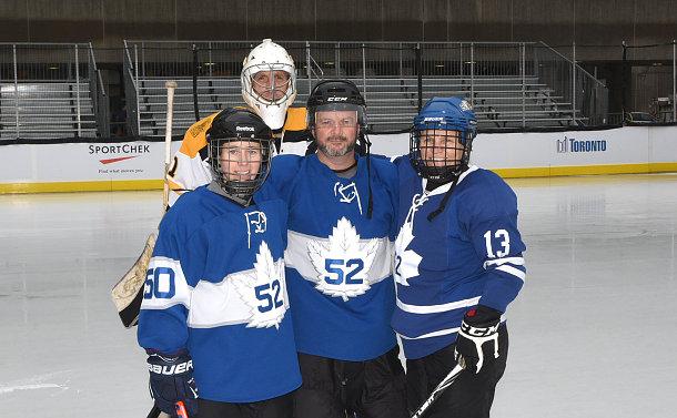 People in hockey gear on ice