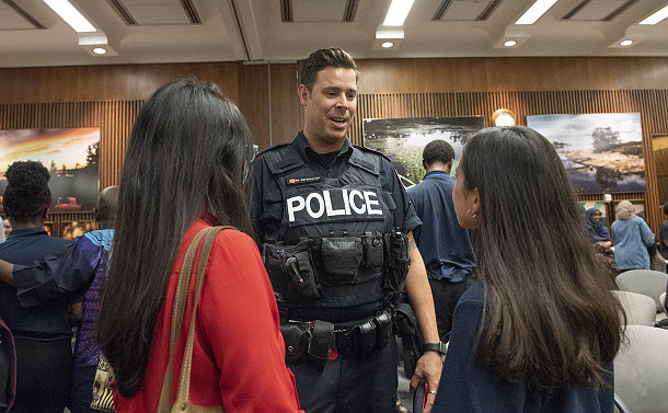 A man in TPS uniform speaks to a girl