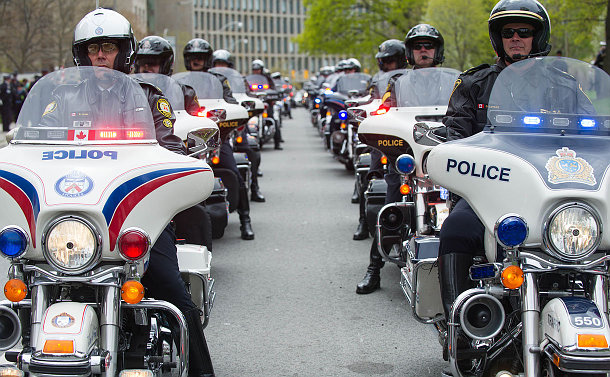 Two rows of motorcycle officers