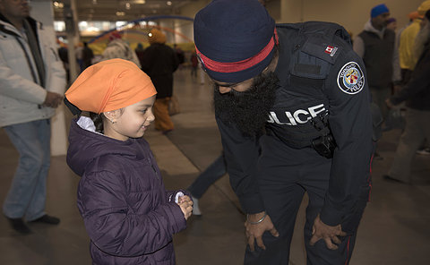 Child and Officer speaking