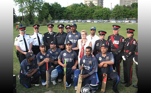 A group of people in TPS uniform and cricket uniform