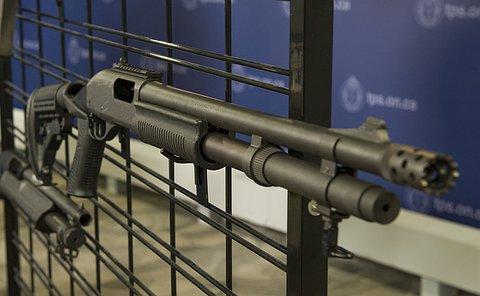 A shotgun on a metal rack