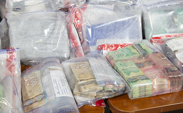 Plastic bags with money and bundled bricks of cocaine