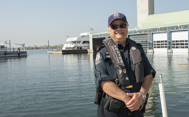 A man in TPS uniform by the water