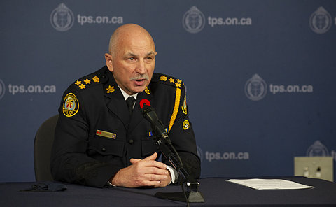 A man in TPS uniform at a table