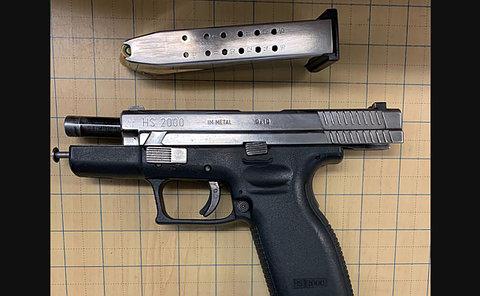 A handgun and ammunition clip