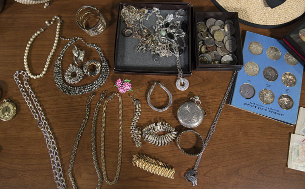 Jewellery and coins on a table