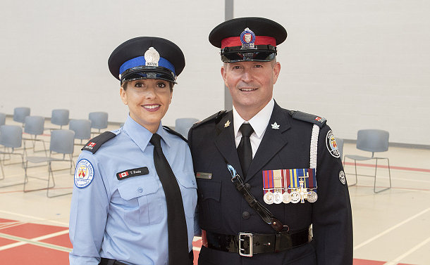 A woman in TPS special constable uniform and a man in TPS police uniform