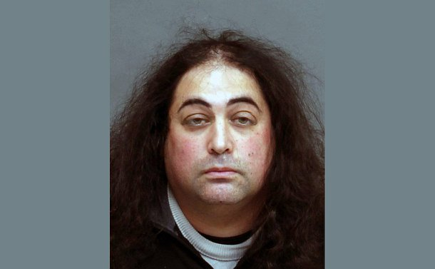 Photo of a man with long frizzy hair