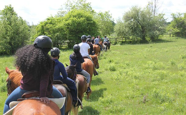 A row of people on horses