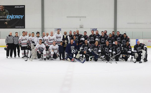 Two hockey teams at centre ice