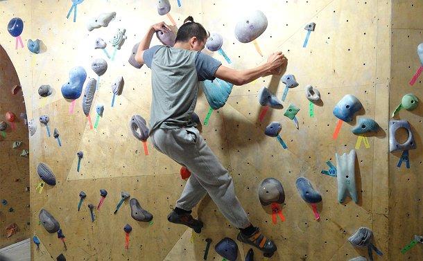 A teenage boy on a rock climbing wall