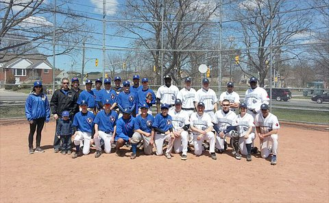 Two baseball teams in group photo at home plate
