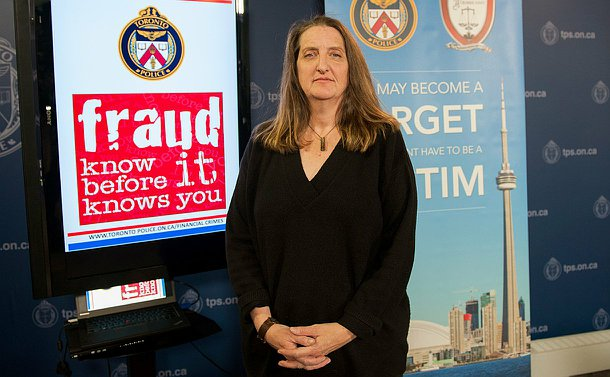 A woman stands beside a TV with the words: Fraud Know It Before It Knows You