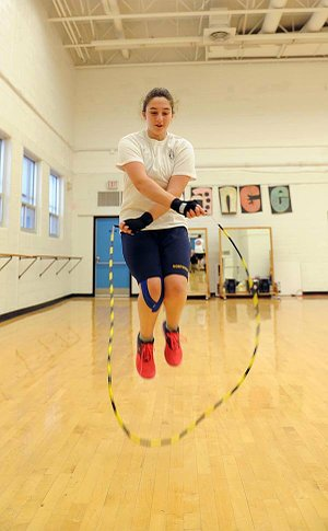 A girl skipping in gym setting