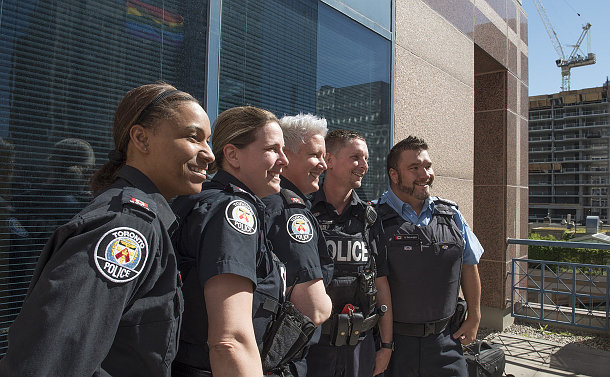 A group of men and women in TPS uniform standing in a line