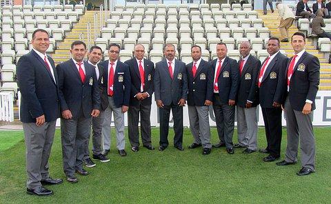 Police cricket team members in cricket formal attire.