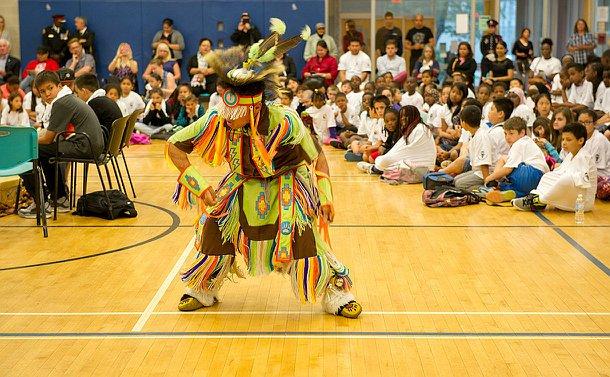 A boy in aboriginal clothing dancing