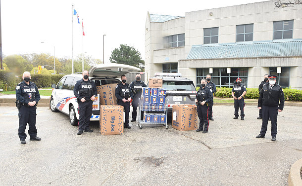 A group of TPS officers near containers of food