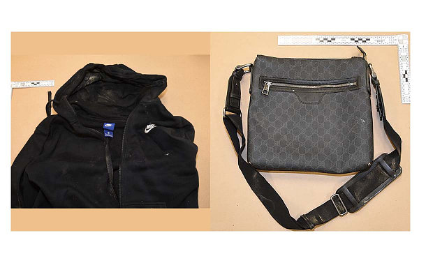 A bag with a strap and black sweatshirt