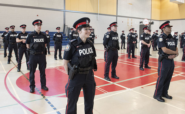 Men and women in TPS uniform