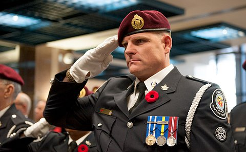 A man in uniform saluting