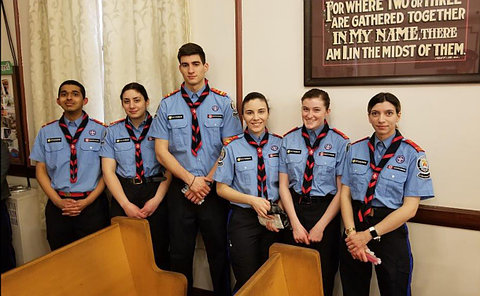 A group of men and women in TPS Rover uniform