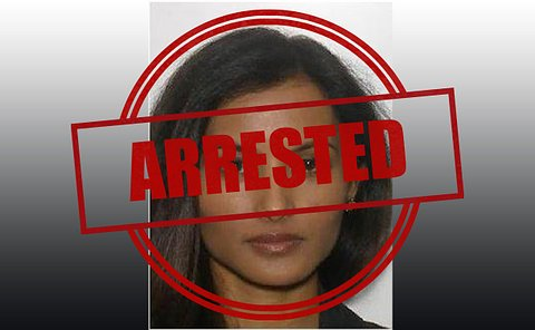 A woman in a mug shot like photo with an arrested stamp on top of it