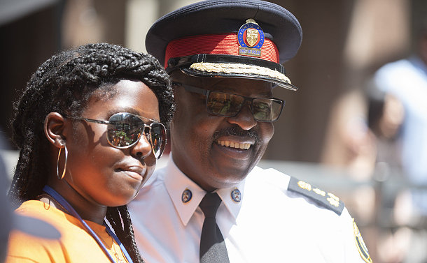 A man in TPS uniform with a girl