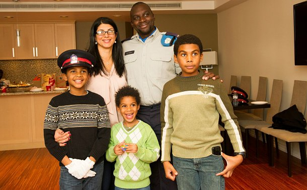 A man in a UN officer uniform with wife and 3 young sons