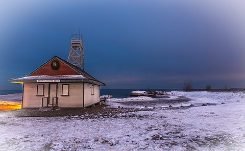 A lifeguard station on the edge of water