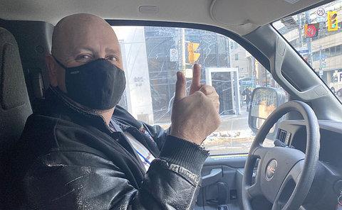 A man driving a truck