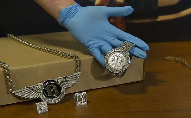 A chain with a Bentley logo and a diamond watch