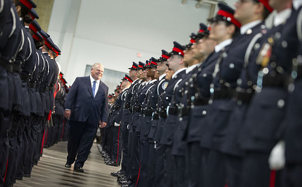 A man walks along a line of police officers