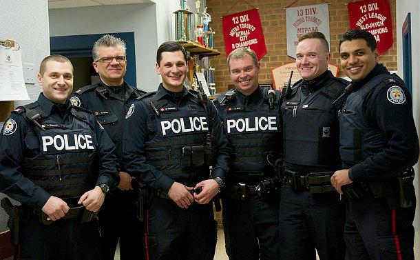 A group of six men in TPS uniform