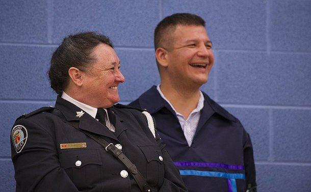 A woman in TPS uniform beside a man
