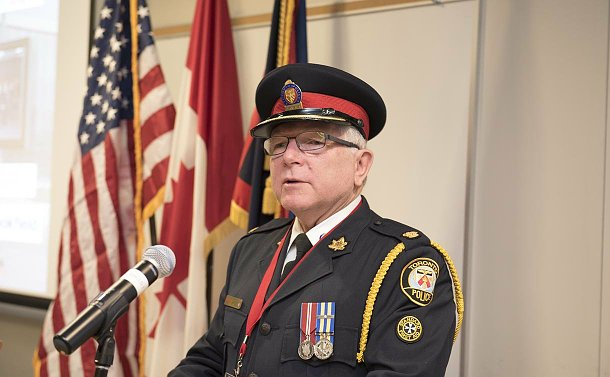 A man in TPS uniform at a podium