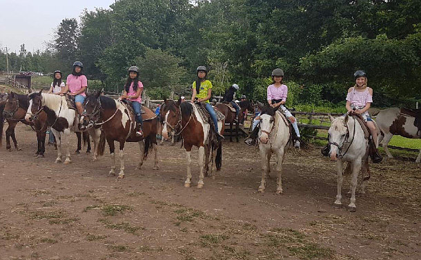 A group of girls on horses