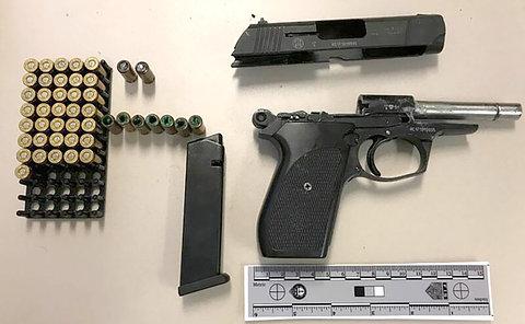 A handgun and ammunition on a table