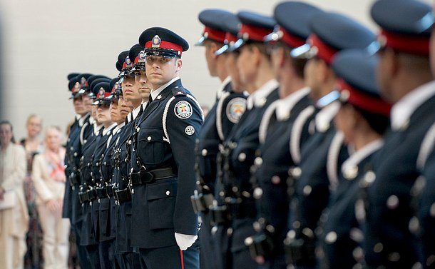 A line of men and women in TPS uniform