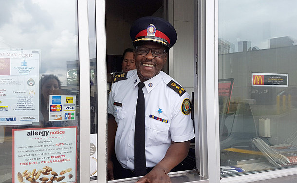 A man in TPS uniform in a drive-thru window