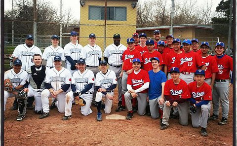 Two teams in group photo by home plate