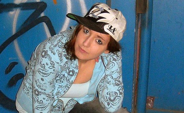 Young girl, wearing a baseball hat