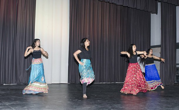 Girls in costume dance on a stage