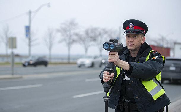 A man with a radar gun