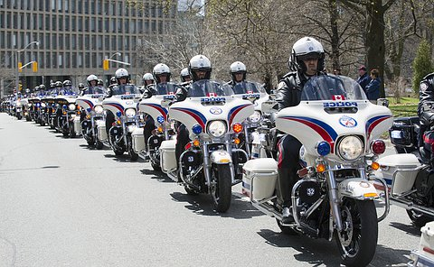 Two long rows of motorcycle officers in TPS uniform