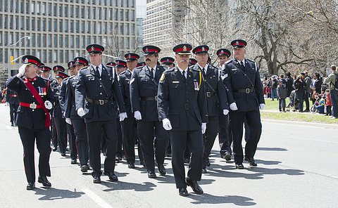 A group of officers in TPS uniform marching on street
