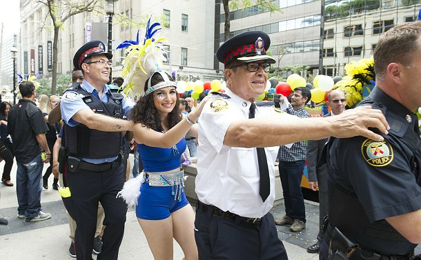 Men in TPS uniform, a girl in a costume in a line