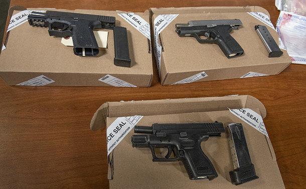 A table with handguns